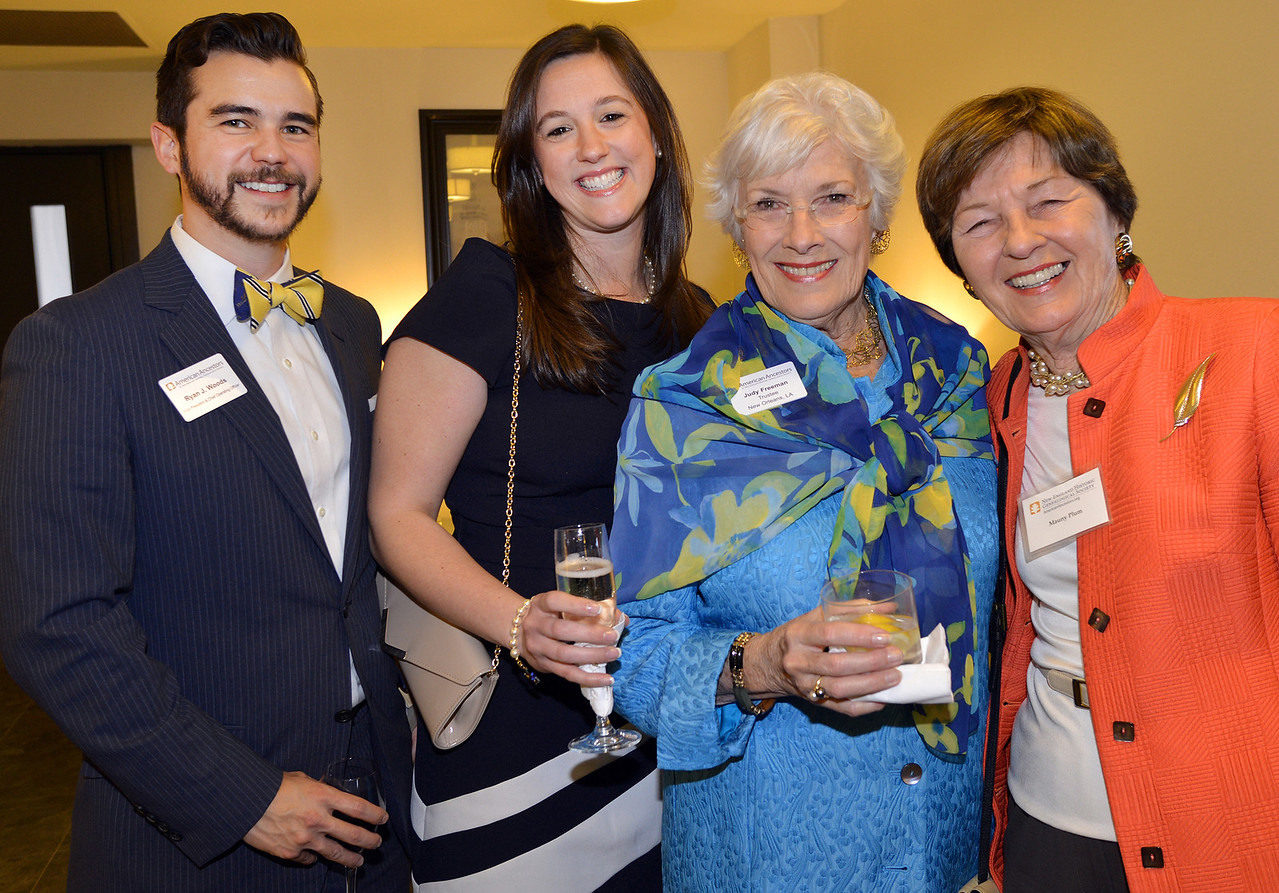 NEHGS Vice President and COO Ryan Woods, Karen Woods, honorary dinner chairperson Judith Waite Freeman, and Mauny Plum.