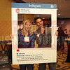 Francesca Loparco and Steven Quintero of Queen City Dream Cars pose for a photo with the CBJ Instragram board.