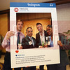 Members of AvidXchange, Inc. pose for a photo with the CBJ Instagram board.