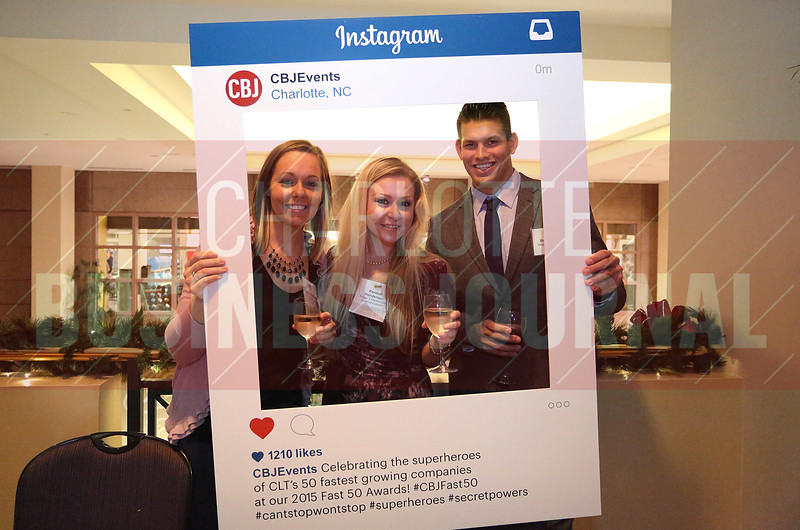 Brianna Houghton, Phase 3, Kendall Henderson, Phase 3, and Steve Dehlin, Integro Technologies, pose for a photo with the CBJ Instagram board.