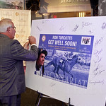 An arriving guest, signed the Get Well Card for Ron Turcotte.