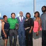 Group photo for the award given to the Most Improved Office Returns & Net Revenue, Broadway,and Managing Partner with J. Hagan, Warren Wealth Advisors LLC, Marcus Warren. ( center).