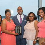 Group photo for the award given to the Top Performing Office-Returns, Taylor Blvd. and Managing Partner with J. Hagan, Warren Wealth Advisors LLC, Marcus Warren. ( center).