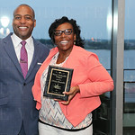 Managing Partner with J. Hagan, Warren Wealth Advisors LLC, Marcus Warren and awardee for the Most Valuable Player Christy Alexander.