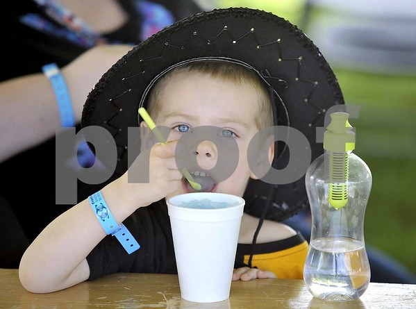 -Messenger photo by Hans Madsen<br /> <br /> With his hat skew, Alan O'Keefe, 5, of Hutchinson, Minnesota, enjoys something blue Friday afternoon at the 41st annual Frontier Days Celebration at the Fort Museum.