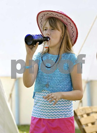 -Messenger photo by Hans Madsen<br /> <br /> Cassie Odom, 9, of Fort Dodge, enjoys a bottle of root beer Friday afternoon at the 41st annual Frontier Days Celebration at the Fort Museum.