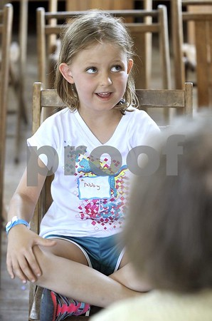 -Messenger photo by Hans Madsen<br /> <br /> Abby Tofilon, 6, of Fort Dodge, thinks carefully about her answer as she participates in the spelling bee Saturday morning during the annual Frontier Days Celebration at the Fort Museum. Tofilon won the kindergarten age division.