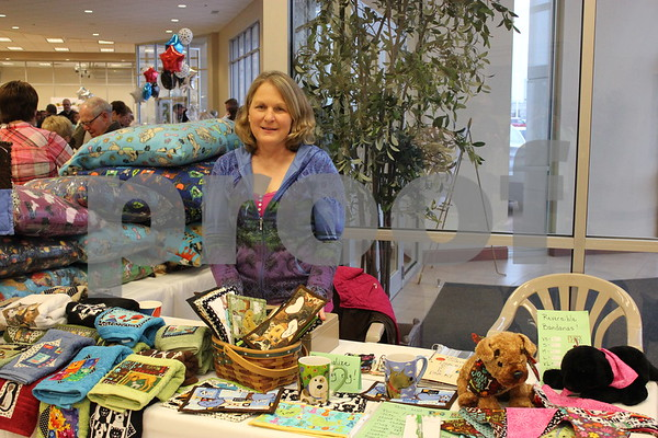 Jan Heitner selling her items she makes for her business to support The Almost Home Animal Shelter.