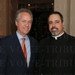 Mayor Greg Fischer and Father Jon Boukis.