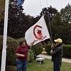 Connie and Brad raise the alumni flag