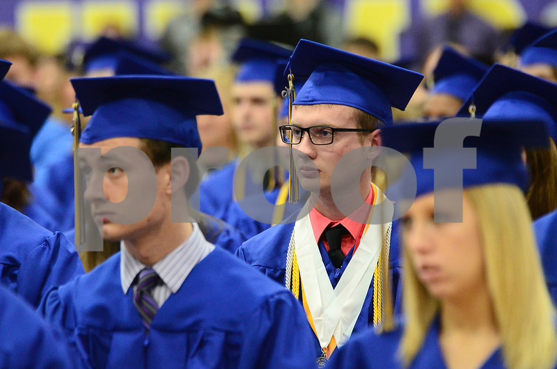 -Messenger photo by Jesse Major<br /> <br /> Humboldt High School graduate Talon Hoefer listens as classmates give advice during graduation Sunday.