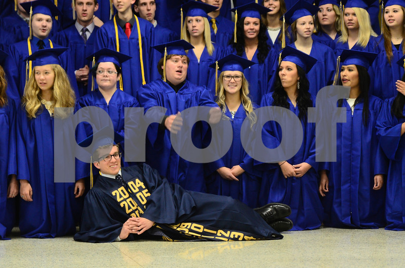 -Messenger photo by Jesse Major<br /> <br /> Humboldt High School senior class president Will Dunscombe lies of the floor in front of his classmates when the gathered for a group photo before graduation Sunday.