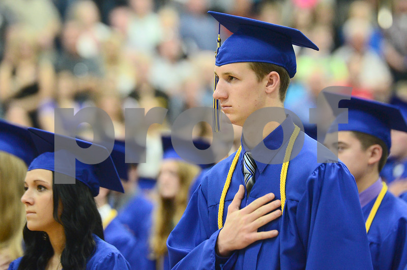 -Messenger photo by Jesse Major<br /> <br /> Humboldt HIgh School graduate Geoffrey Bruder puts his hand over his heart as the Star Spangled Banner is played at graduation Sunday.