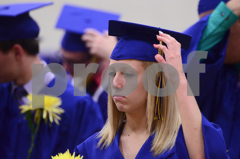 -Messenger photo by Jesse Major<br /> <br /> Humbolt High School graduate Taylor Christensen turns her tassel over after graduation Sunday.