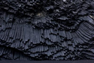 The black basalt columns & black sand beach of Reynisdrangar