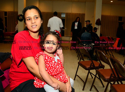 12/1/2015 Mike Orazzi | Staff Ashley Rosario and her daughter Daniely  during the World AIDS Day event at South Congregational Church in New Britain on Tuesday night.