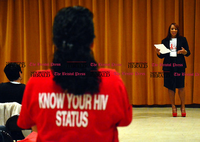 12/1/2015 Mike Orazzi | Staff Delita Rose Daniels, HRA Case Manager, during the World AIDS Day event at South Congregational Church in New Britain on Tuesday night.