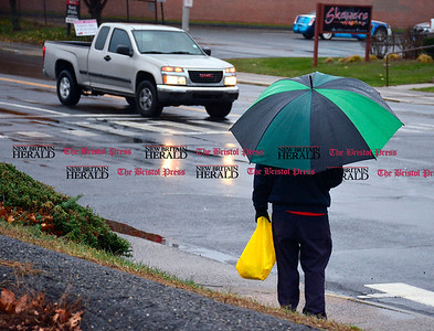 12/1/2015 Mike Orazzi | Staff A rainy North Main Street in Bristol Tuesday afternoon.