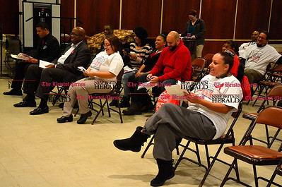 12/1/2015 Mike Orazzi | Staff Ashia Cruz (far right) during the World AIDS Day event at South Congregational Church in New Britain on Tuesday night.