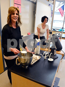 4/1/2015 Mike Orazzi | Staff Sisters Rosa Rocco and Tina Autunno during a cook demonstration for French/Italian Club at Plainville High School on Wednesday.