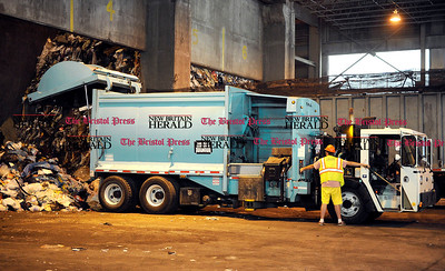 8/3/2011 Mike Orazzi | Staff A truck unloads refuse at the Covanta Energy plant on Enterprise Drive. *** for a Robert story**