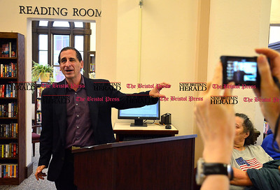 10/11/2014 Mike Orazzi | Staff The Simpsons producer Mike Reiss during a visit to the Bristol Public Library on Saturday. Reiss had a section of the library dedicated to him during a short ceremony.