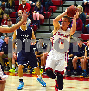 1/2/2015 Mike Orazzi | Staff Berlin's Evan McKinnen (10) during Friday night's basketball game with RHAM.
