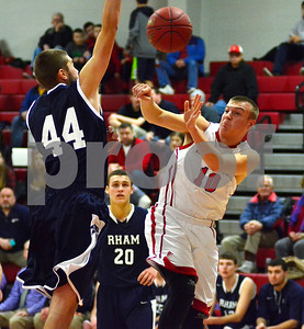 1/2/2015 Mike Orazzi | Staff Berlin's Kyle Mahoney (13) and RHAM's Tristan Allen(44) during Friday night's basketball in Berlin.