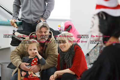 Tom and Debbie Case of Saratoga Springs NY sit with their grand daughter Allison Dietrichsen 2 of Middletown Sunday during a Read Across America and Dr Seuss birthday celebration at the Imagine Nation Museum in Bristol  Mar. 1, 2015 | Justin Weekes / For the New Britain Herald