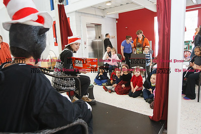 Ali Feigen reads Green Eggs and Ham to kids Sunday during a Read Across America and Dr Seuss birthday celebration at the Imagine Nation Museum in Bristol  Mar. 1, 2015 | Justin Weekes / For the New Britain Herald