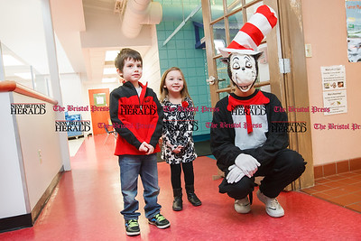 Seth Begin 6 of New Hartford and Whitney Turney 4 of Farmington pose for a pic with the Cat in the Hat Sunday during a Read Across America and Dr Seuss birthday celebration at the Imagine Nation Museum in Bristol  Mar. 1, 2015 | Justin Weekes / For the New Britain Herald