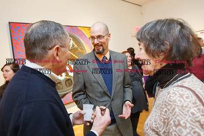 Karl Lund visits with Joan and Charles Leach of Farmington Sunday during a exhibit opening Angry Robots Liquefied My Brain by Karl Lund at the New Britain Museum for American Art in New Britain  Mar. 1, 2015 | Justin Weekes / For the New Britain Herald