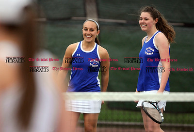 5/1/2015 Mike Orazzi | Staff Berlin's Tori Mancini and Bridget Fox during a tennis match Friday.