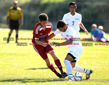 9/16/2015 Mike Orazzi   Staff Berlin's Curtis Arcari(13) and Bristol Central's Andrew Marcantonio(9) during soccer on Wednesday afternoon at BC in Bristol.