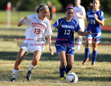 9/15/2015 Mike Orazzi | Staff Terryville's Zoe Jobs (13) and Nonnewaug's Kaci Michaud (13) during soccer at THS on Tuesday.