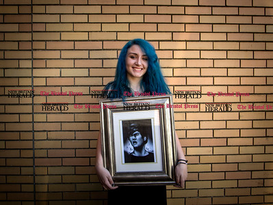 09.16.15 Amelia Parlier   Special to the Herald Fourteen year old artist Tiana Marie Mandell with one of her pieces that is currently on display at the New Britain Public Library.