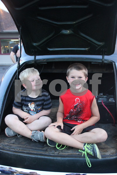 Seen here is  (left to right) : Corbin and Nolan Eslick sitting in the back of their grandparent's late model car, that they brought to the Ja-Mars Cruise night to share with other car enthusiasts present at the event. The event took place at Jar-Mars in Fort Dodge on Friday, August 7, 2015.