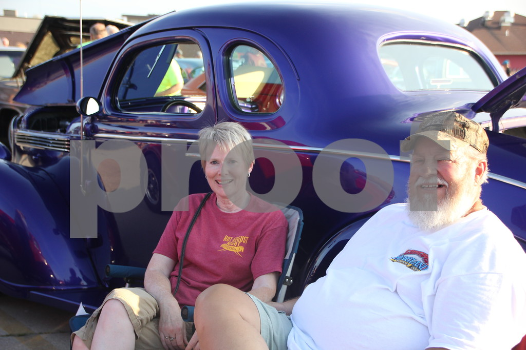 Pictured here is Larry and Angie Jewett with their late model car  they brought to share with other car fans at the Ja-Mars Cruise night at Ja-Mars in Fort Dodge on Friday, August 7, 2015.