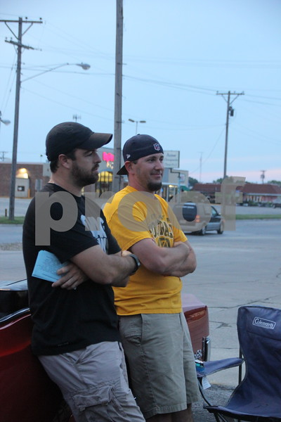 Ryan O'Leary and Greg Swanson are pictured here taking in the  wide variety of late makes and models of cars that were brought by their owners to the Ja-Mars Cruise night at Ja-Mars in Fort Dodge. The event took place on Friday, August 7, 2015.