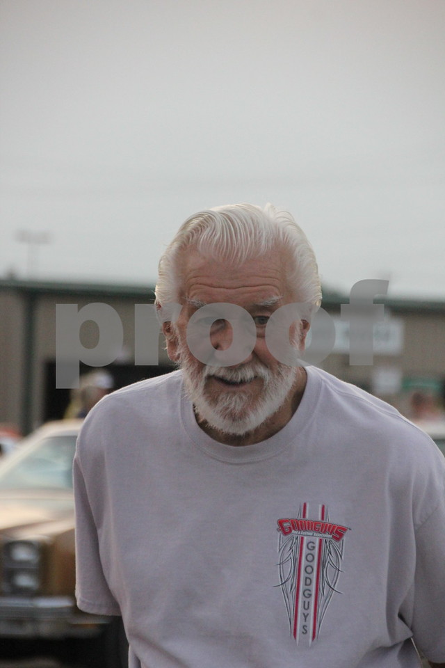 Friday, August 7, 2015 Ja-Mars in Fort Dodge held the Ja-Mars Cruise night there where owners of  various late model cars brought their  cars to share with other  car fans. Pictured here is : Marvin Grebner, one of several who came to enjoy the event.