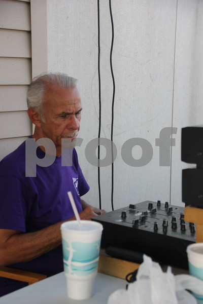 "The DJ for the Ja-Mars Cruise night is pictured here. His name is: John Francis also known as ""Honest John"" . He was another of several who helped make the event fun as he helped out. The event was held at Ja-Mars in Fort Dodge on Friday, August 7, 2015."