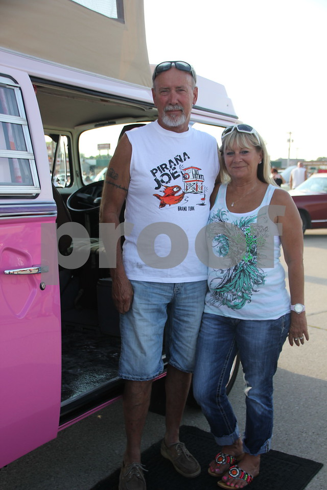 Seen here is Curt and Cindy Bacon next to Cindy's Volkswagon van that sports a popup on the roof for extra room when camping out. They were among the  large  number of  owners who brought their cars out to share with other car enthusiasts at the Ja-Mars Cruise night held at Ja-Mars on Friday, August 7, 2015 in Fort Dodge.