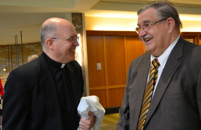 Fr. Steve jokes with Br. Frank before the celebration