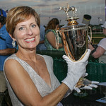 Patty Frazier with one of the golden trphies presented to the team of American Pharoah.