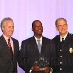 Mayor Greg Fischer, awardee James Rice and Police Chief Steve Conrad.