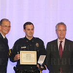 Chief of Police Steve Conrad, Medal of Honor awardee Officer Cole Gibson and Mayor Greg Fischer.
