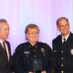 Mayor Greg Fischer, Distinguished Community Service  Award  recipient Sgt. Amy Chambers  and Chief of Police Steve Conrad.