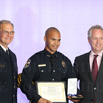 Chief of Police Steve Conrad, Medal of Honor awardee Officer Milton Santos and Mayor Greg Fischer.