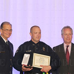 Chief of Police Steve Conrad, Medal of Valor awardee Officer Bryan Wilson and Mayor Greg Fischer.
