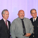 Mayor Greg Fischer, Distinguished Citizen Award  recipient Jerry Majers and Chief of Police Steve Conrad.